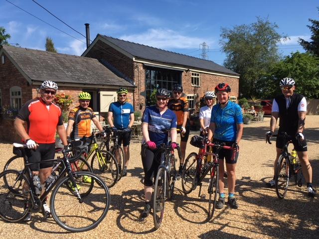 Active riders enjoying a sunny stop at Barnshaw Smithy